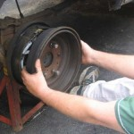 4. Use brake drum as a slide hammer until axle bearing clears housing.