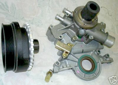 Figure 3a. Typical 5.0 Explorer timing cover and integral balancer-crank pulley. You will want to substitute the gold piece in this picture (crank position sensor, which you will not need) with a simple timing pointer (see Figure 4).