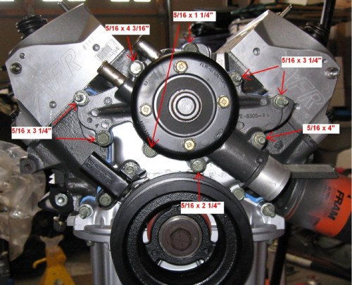 Figure 4A. Water pump mounting bolts. Also in this picture you can see the Explorer timing sensor (which you will remove and replace with a timing pointer) at the 10 o'clock position next to the crankshaft pulley
